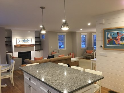 West Yarmouth Cape Cod vacation rental - Open floor plan to dining/living room features a gas fireplace.
