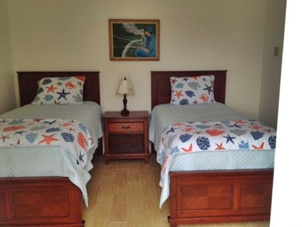 Eastham Cape Cod vacation rental - 1st floor bedroom with private bath and sliders to garden