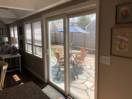 Harwich Port Cape Cod vacation rental - Inside looking out at patio