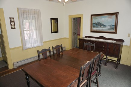 Harwich Port Cape Cod vacation rental - Dining room, table seats 6, with slider to back deck.