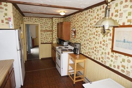 Harwich Port Cape Cod vacation rental - Kitchen with oven, microwave, toaster, coffee maker.