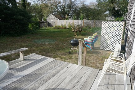 Harwich Port Cape Cod vacation rental - Deck off dining room with grill and table and chairs