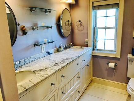 Brewster Cape Cod vacation rental - Master bathroom with jacuzzi tub and shower.