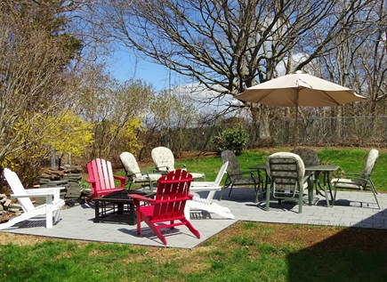 Falmouth Cape Cod vacation rental - Back patio with fire pit and grill