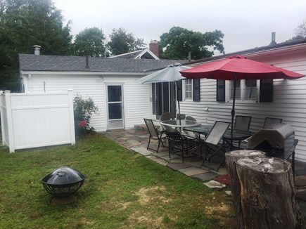 Falmouth Cape Cod vacation rental - View of the patio & backyard, inc the enclosed outdoor shower