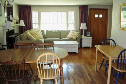Falmouth Cape Cod vacation rental - DR into the LR. Open layout. Flat screen TV is unseen