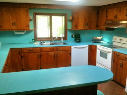 Falmouth Cape Cod vacation rental - The large kitchen has awesome retro blue counters! & a skylight!