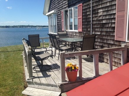 Bourne Cape Cod vacation rental - Relax, sun and dine on water view deck.
