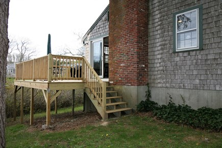 Orleans Cape Cod vacation rental - Deck leads to grassy back yard