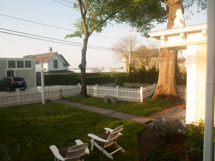 Provincetown Cape Cod vacation rental - Front yard with Adirondack chairs and view to harbor.