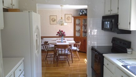South Dennis Cape Cod vacation rental - Fully stocked kitchen leading into the dining room.