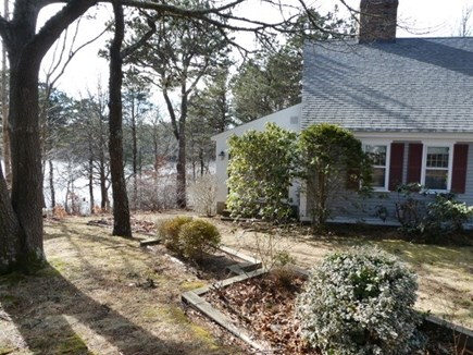 Brewster Cape Cod vacation rental - Large landscaped yard directly on pond.