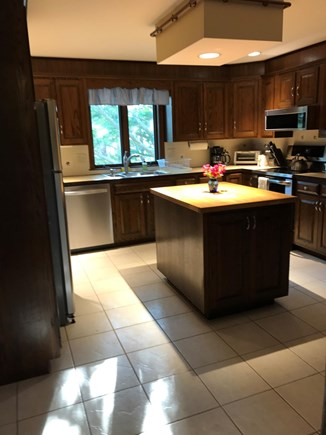 Brewster Cape Cod vacation rental - Modern kitchen with island and view.