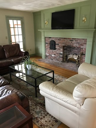 Brewster Cape Cod vacation rental - Family room with large screen smart TV opens to screened porch.