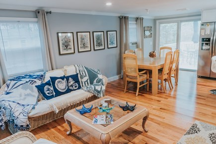 East Falmouth Cape Cod vacation rental - Living room & sliders to deck from the dining area