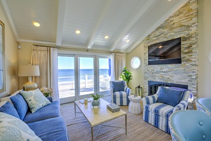 East Sandwich Cape Cod vacation rental - Kitchen opens to Living Room with gas fireplace and slider to dec