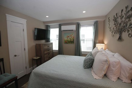Provincetown Cape Cod vacation rental - Master bedroom with queen bed and TV