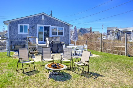 East Sandwich Cape Cod vacation rental - Deck, patio and firepit off the Living Room slider.