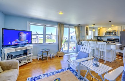 East Sandwich Cape Cod vacation rental - Kitchen opens to Living area with slider to deck.
