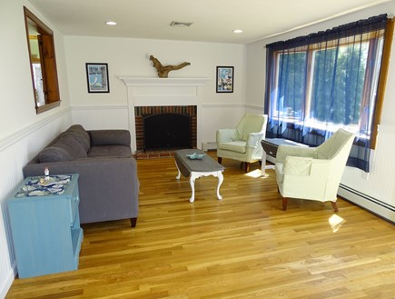 Harwich Cape Cod vacation rental - Front living room with bay window, fireplace