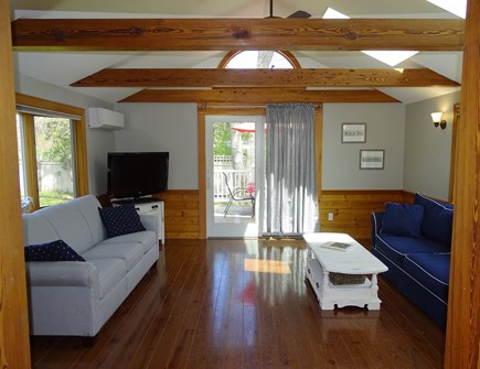 Harwich Cape Cod vacation rental - Sunny, vaulted family room with TV, slider to back deck