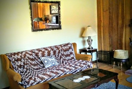 East Falmouth on fresh pond Cape Cod vacation rental - Living room: couch, coffee table, antique table lamp & big mirror