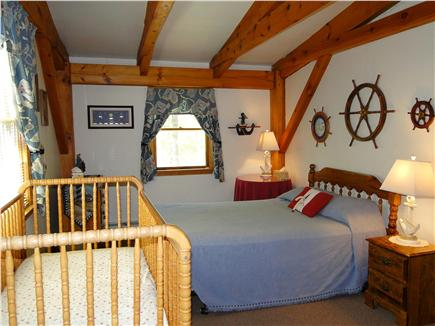 Dennis Cape Cod vacation rental - Upstairs queen bedroom with crib and extra twin bed