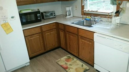 Wellfleet Cape Cod vacation rental - Upper eat-in kitchen has sliders which open to the large deck