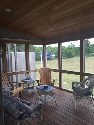 Wellfleet Cape Cod vacation rental - Screened in porch with large back yard and outdoor shower (left)