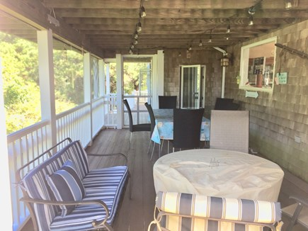 Truro Cape Cod vacation rental - Screened In Porch.W/ Gas Fire Pit & Dining Table.