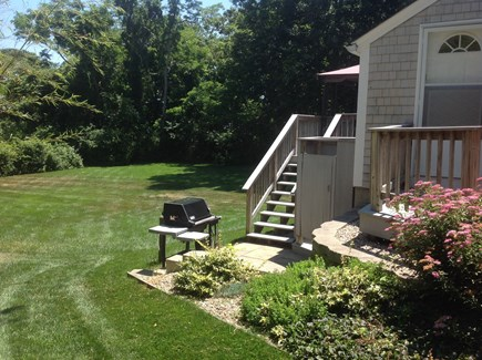 Hyannis Cape Cod vacation rental - Walkway to back yard and grilling area