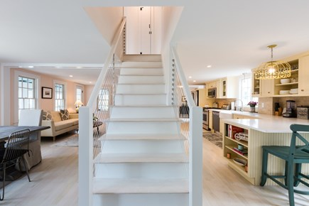 Barnstable Cape Cod vacation rental - Central staircase holds curious appeal