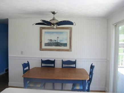 Falmouth Cape Cod vacation rental - Kitchen eating area with slider to large deck