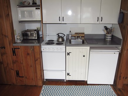 Chatham village Cape Cod vacation rental - Kitchenette is equipped with electric stove, oven, microwave.