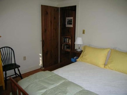 Chatham village Cape Cod vacation rental - Cozy bedroom with queen bed w/ dresser and original art.