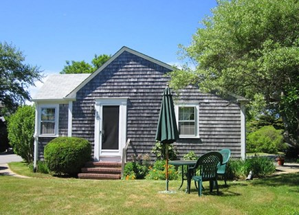Chatham village Cape Cod vacation rental - South facing exterior of cottage overlooks large,private backyard