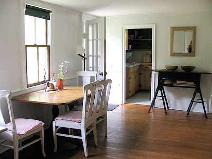 Wellfleet Cape Cod vacation rental - Dining area, kitchen area in background, front entrance on left