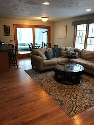 Yarmouth Port Cape Cod vacation rental - Living room/kitchen with sunroom overlooking patio and pool