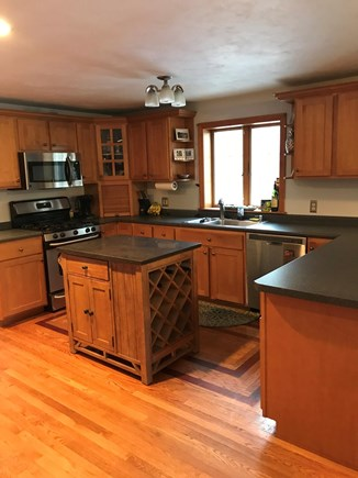 Yarmouth Port Cape Cod vacation rental - Kitchen with 5 burner gas stove, dishwasher, and stainless fridge
