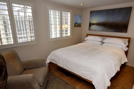 Provincetown Cape Cod vacation rental - Bedroom with perfect chair to read a book.