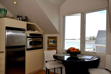 Provincetown Cape Cod vacation rental - Enjoy a meal or a cup of coffee looking out over the bay.