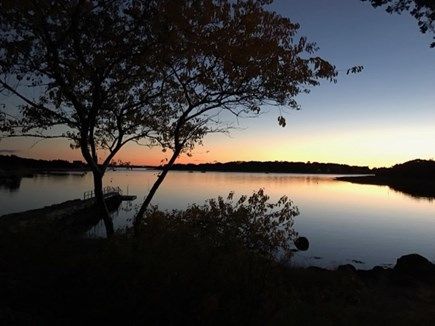 West Falmouth Cape Cod vacation rental - Sunset views off the deck, Living Room and three Bedrooms.