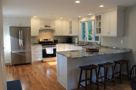 Harwich Cape Cod vacation rental - Kitchen with stainless steel appliances and granite countertops.