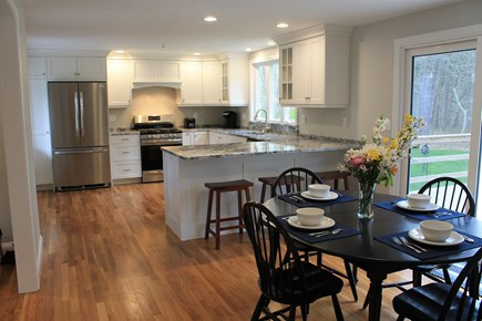 Harwich Cape Cod vacation rental - Open dining room and kitchen area