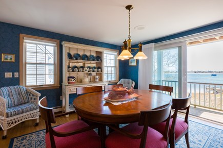 Orleans, Chatham  Cape Cod vacation rental - Dining room off the kitchen with deck access and water views