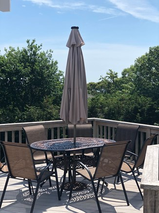Orleans Cape Cod vacation rental - Deck with table and seating for eight plus a stainless gas grill.