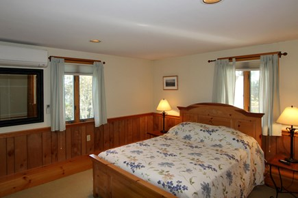 Orleans Cape Cod vacation rental - Master bedroom downstairs with a queen sized bed and bath.