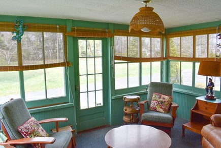 West Dennis Cape Cod vacation rental - Sunroom overlooking driveway and field
