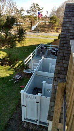 West Dennis Cape Cod vacation rental - Rear of House and outside Showers/ Deck on stairway to Roof Deck
