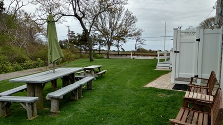 West Dennis Cape Cod vacation rental - Side Yard by the showers toward Marsh and Ocean